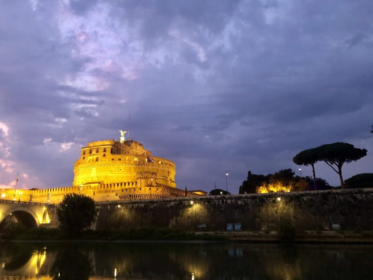 Castel Sant'Angelo glowing in the night as the sun sets
