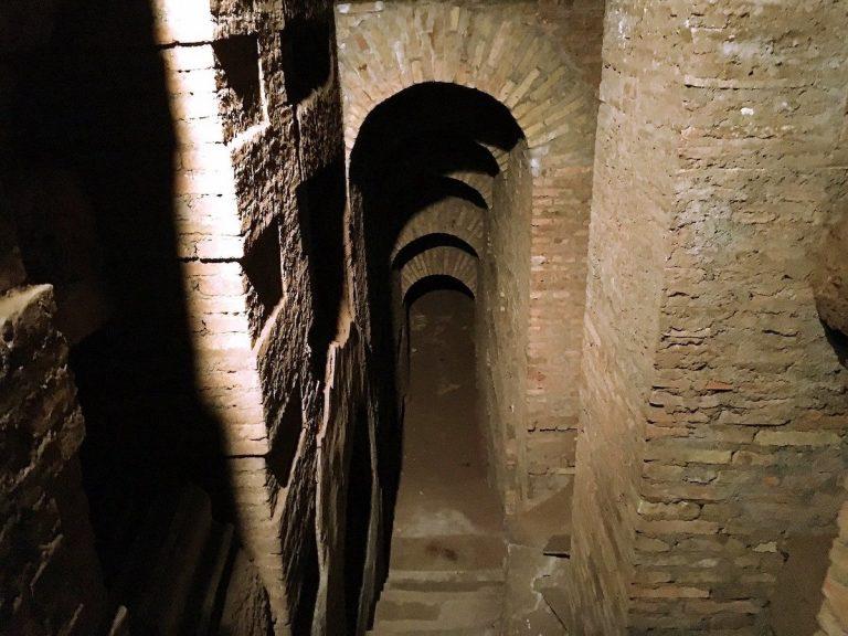 Dark stairway down into Roman Catacombs