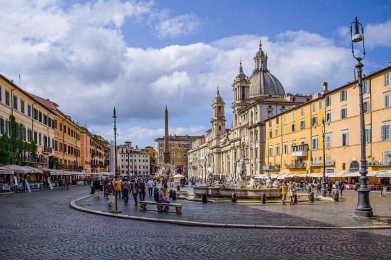 People sat eating at restaurants in Piazza Navona