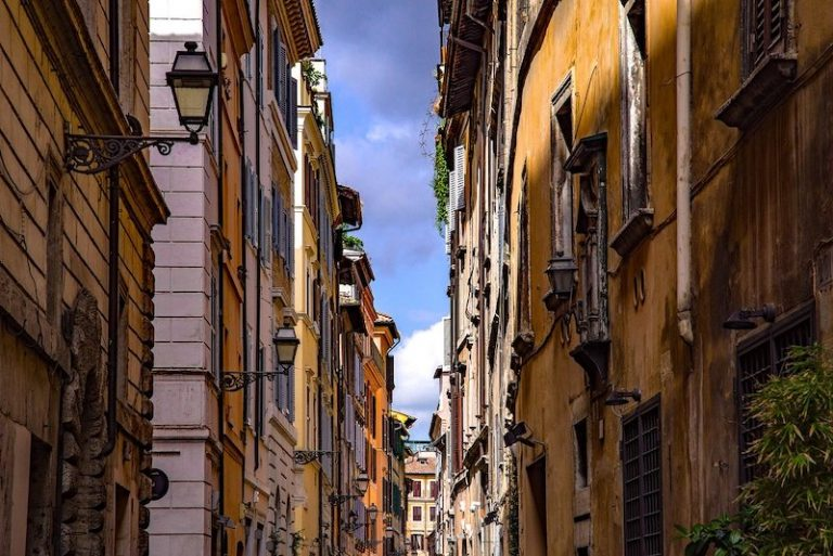 Narrow street in Rome with buildings either side