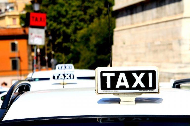 Roman taxi sat in a rank taxi rank