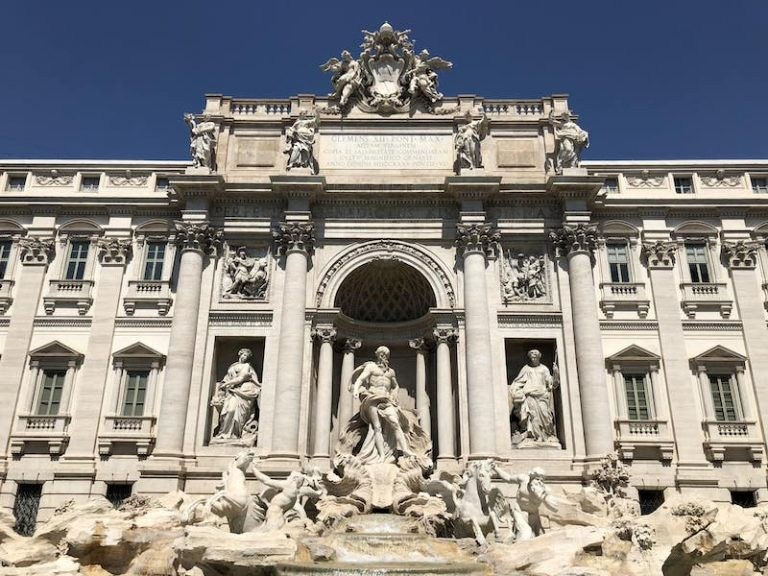 Trevi Fountain in the daytime with bright blue sky