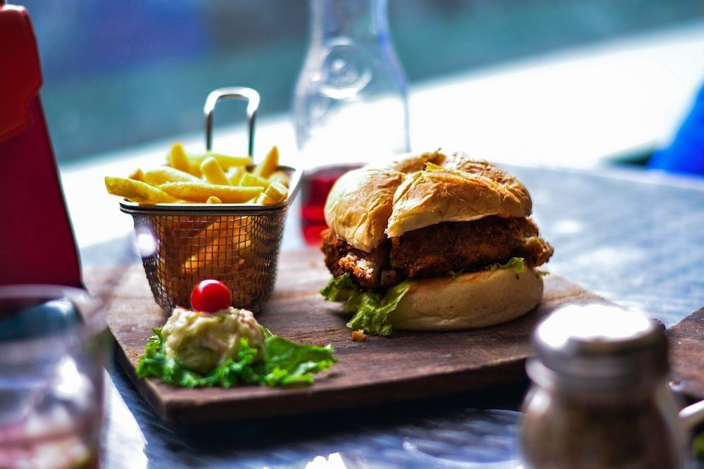 Burger and chips on a plate in a restaurant