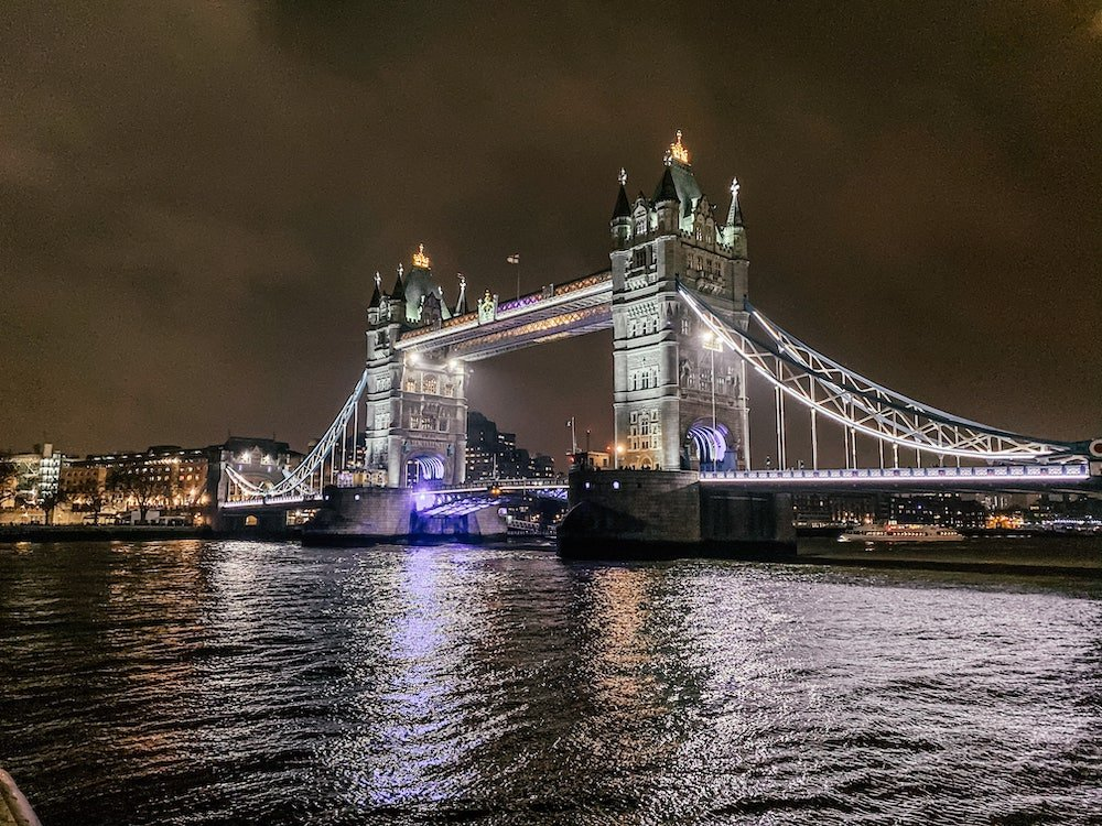 Tower Bridge at night time with a reflection in the river