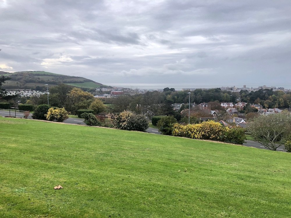 View of buildings from the national library of Wales, with cloudy skies